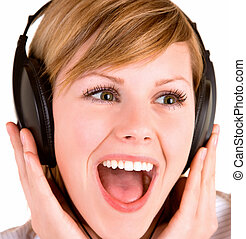 A beautiful lady is listening to music with headphones.