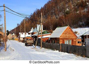 Listvianka settlement. Lake Baikal. Winter. Group of houses....