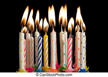 lit birthday celebration candles