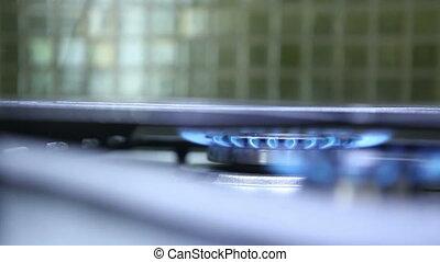 lit burner on the gas stove