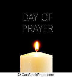 lit candle and text day of prayer
