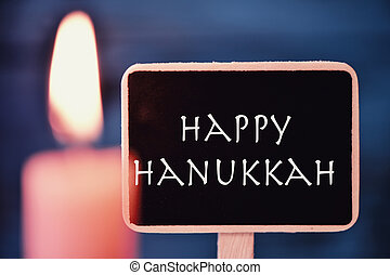 lit candle and text happy Hanukkah