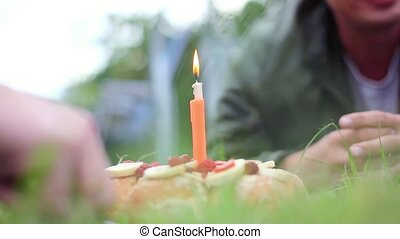 lit candle in the shape of figure one in the park celebrating the first year of birthday with cake. 1920x1080