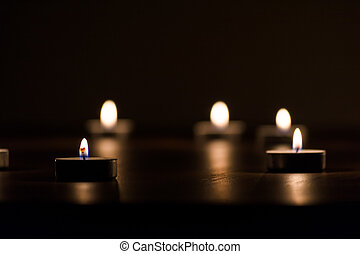 Lit Candles in the Dark