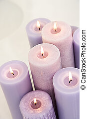 Lit lavendar candles. - Close up of lit lavendar candles.