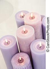 Lit lavendar candles. - Close up of lit lavendar candles.