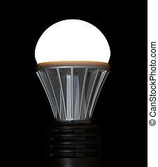Lit LED Light Bulb - A lit LED bulb isolated on a black ...
