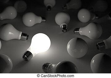 One lit light bulb amongst other broken light bulbs