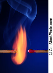 burning and unlit match on the blue background