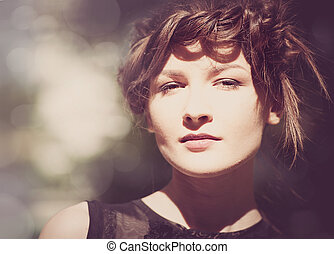 Lite sepia colorized vintage female portrait with beauty bokeh