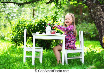 liten flicka, te, le, fest.
