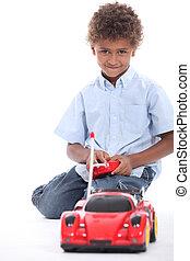 liten pojke, leka, med, a, leksak bil