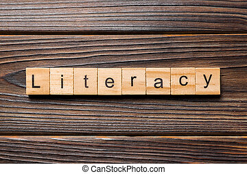 LITERACY word written on wood block. LITERACY text on wooden table for your desing, concept