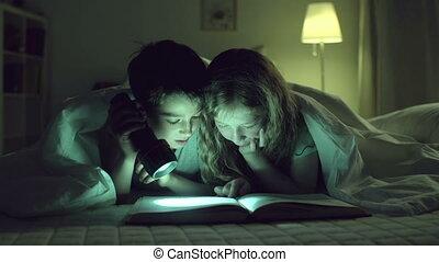 Literary soiree - Children in nursery skimming book in...