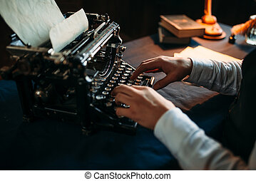Literature author in glasses typing on typewriter - Portrait...