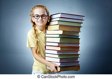 Literature girl - Image of happy schoolgirl with stack of...