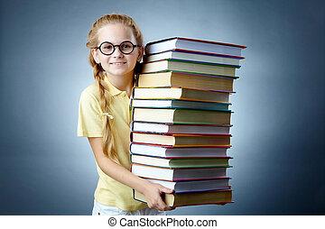 Literature girl - Image of happy schoolgirl with stack of...