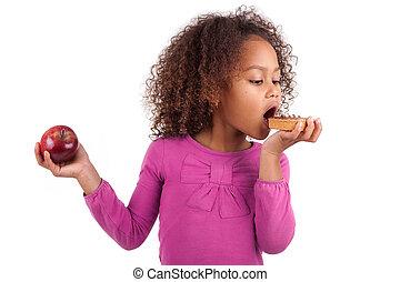 litet, afrikansk, asiatisk flicka, ätande en choklad, tårta