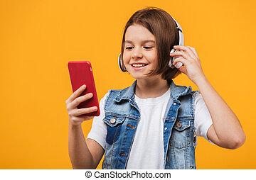 litet, glad, musik lyssna, skolflicka, stående