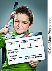 litet, skådespelare, med, a, skiffer, in, hans, huvud