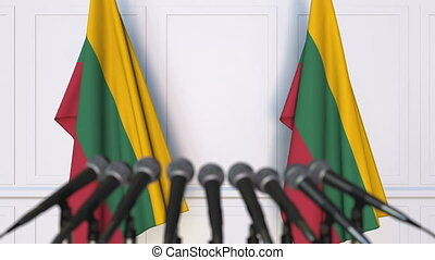 Lithuanian official press conference. Flags of Lithuania and...