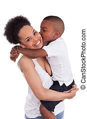 Litte black boy kissing her mother