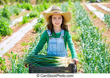 Litte kid farmer girl in onion harvest orchard - Litte kid...