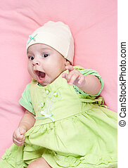 Little 3 months baby-girl dressed in green suit portrait