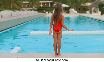 Little adorable girl have fun in outdoor swimming pool