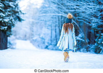 Little adorable girl with in winter day outdoors