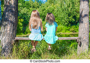 Little adorable girls outdoors at summer time - Little...
