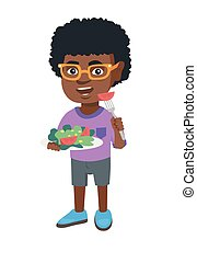 Little african-american boy eating vegetable salad