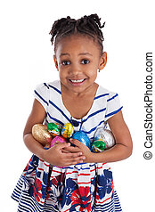 Little african american girl holding chocolate easter eggs, isolated on white background