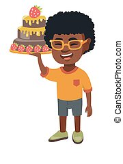 Little african boy holding a chocolate cake.