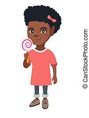 Little african girl holding a lollipop candy.