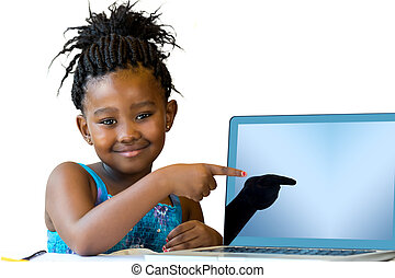 Little african girl pointing at blank laptop screen.