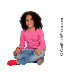Little african girl sitting on the floor