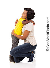 little afro american boy hugging his mother