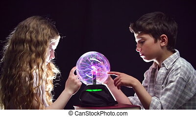 Little Alchemists - Static shot of kids gazing at magic ball...