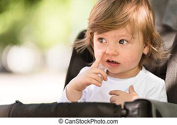baby girl sitting in the pram