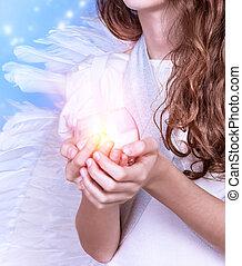 Little angel - Closeup on little angel holding in hands ...
