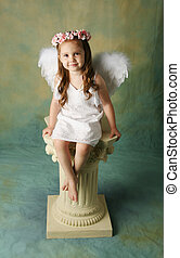 Little Angel Girl - Beautiful young girl wearing angel wings...