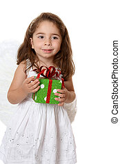 Little angel girl holding a gift
