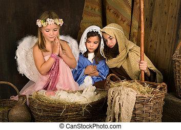 Little angel in nativity scene