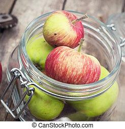 little apples in a glass jar