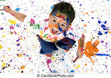 Little Artist - Adorable 3 year old boy covered in bright ...