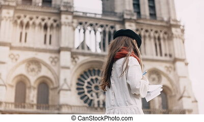 Little artist beret drawing near the Notre Dame in Paris,...