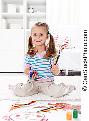 Little artist girl painting at home