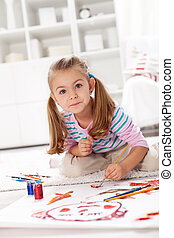 Little artist girl painting