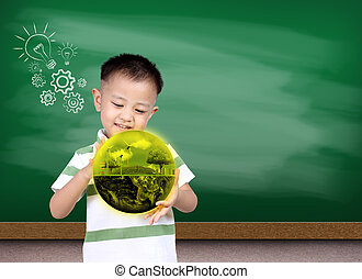 Little asia boy holding the earth with Green chalk board, (Knowl